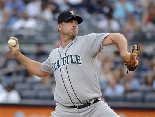 Seattle Mariners starting pitcher Kevin Millwood throws to a New York Yankees batter in the first inning of a baseball game Friday, Aug. 3, 2012, at Yankee Stadium in New York. (AP Photo/Kathy Kmonicek)