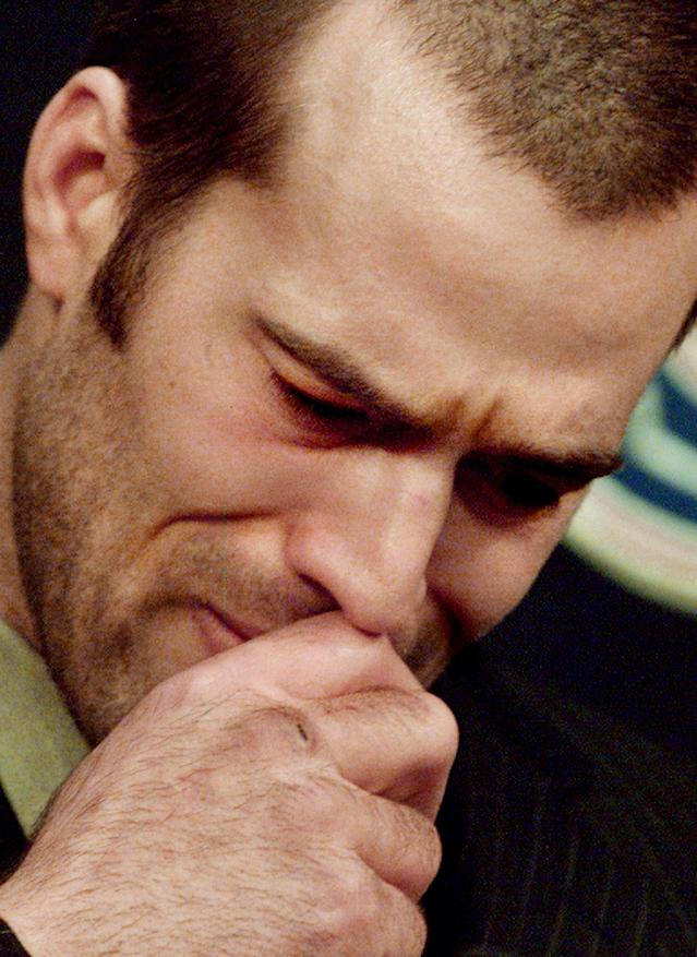 FILE - In this March 10, 2004, file photo, Vancouver Canucks NHL hockey player Todd Bertuzzi fight tears as he apologizes for hurting Colorado Avalanche player Steve Moore during a news conference at GM Place in Vancouver. A settlement has been reached in Moore's lawsuit against Bertuzzi for his career-ending hit during an NHL game 10 years ago. (AP Photo/Chuck Stoody, File)