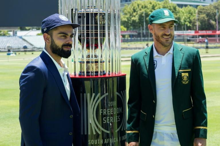 Teams' captains, India's Virat Kohli (L) and South Africa's Faf du Plessis, pose with the 2018 Freedom Series trophy, at the Newlands Cricket ground in Cape Town, prior to their Test match series, on January 3