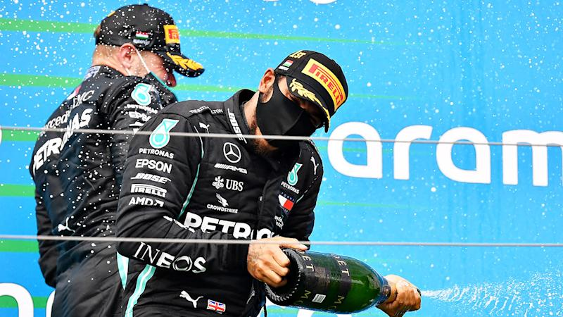 Pictured here, Lewis Hamilton pops the champagne after winning the Hungarian GP.