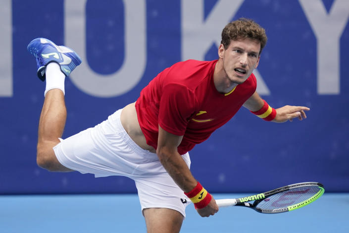 Pablo Carreno Busta, of Spain, serves to Karen Khachanov, of the Russian Olympic Committee, during the semifinal round of the men's tennis competition at the 2020 Summer Olympics, Friday, July 30, 2021, in Tokyo, Japan. (AP Photo/Patrick Semansky)