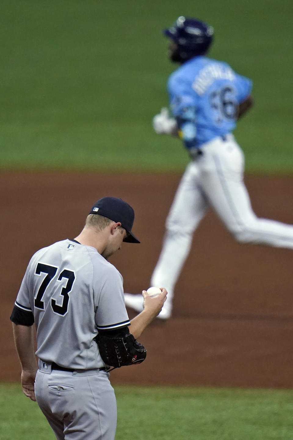 New York Yankees pitcher Michael King reacts as Tampa Bay Rays' Randy Arozarena runs around the bases after hitting a three-run home run during the sixth inning of a baseball game Thursday, May 13, 2021, in St. Petersburg, Fla. (AP Photo/Chris O'Meara)