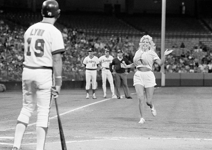 """Morganna """"The Kissing Bandit"""" started her act in 1969, she said, and planted kisses on dozens of players including the Angels' Fred Lynn. (AP Photo/Lennox McLendon)"""
