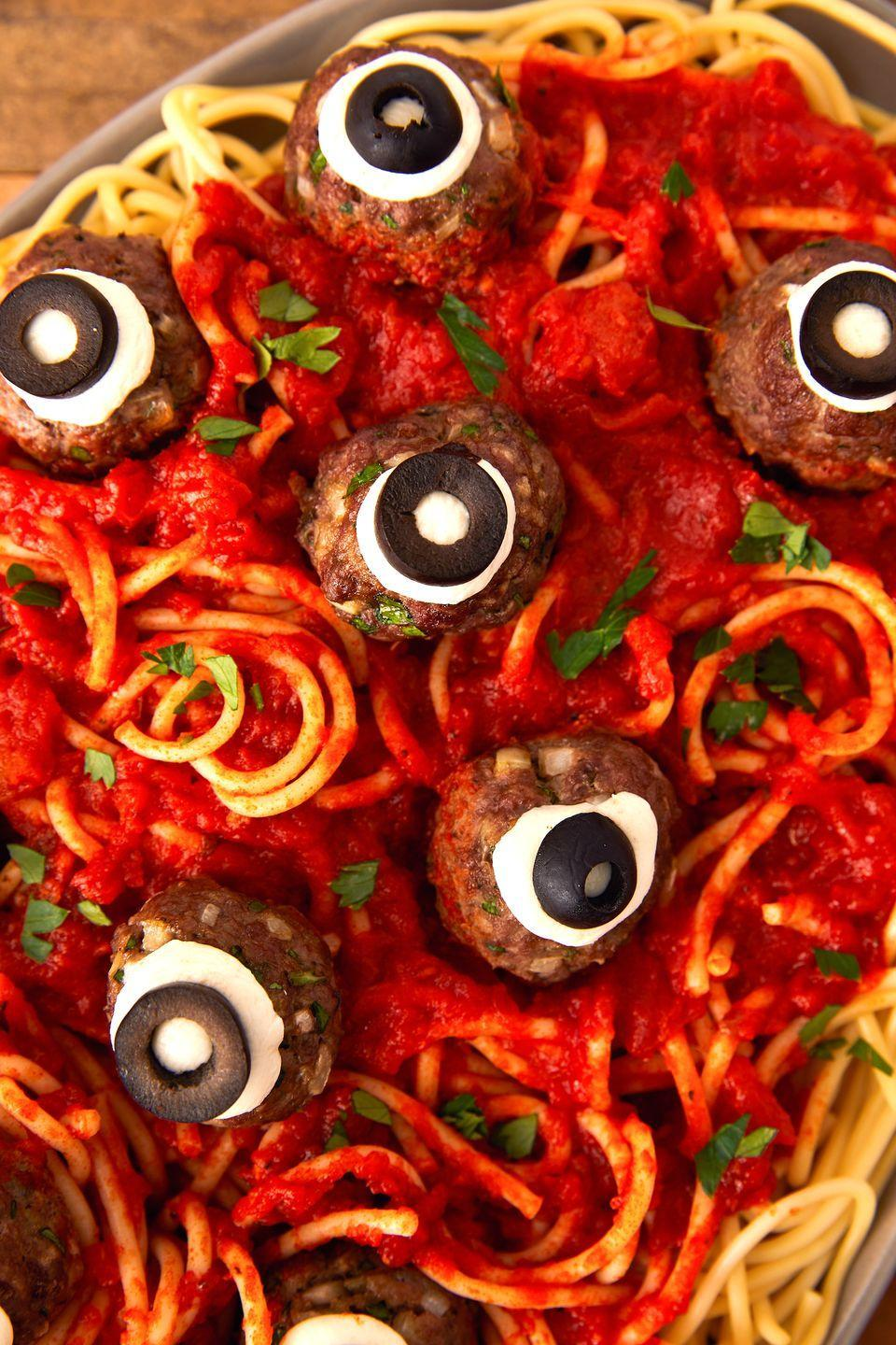 "<p>Meatballs become eyeballs on Halloween!</p><p>Get the recipe from <a href=""https://www.delish.com/cooking/recipe-ideas/a23712888/eyeball-pasta-halloween-dinner-recipe/"" rel=""nofollow noopener"" target=""_blank"" data-ylk=""slk:Delish"" class=""link rapid-noclick-resp"">Delish</a>. </p>"