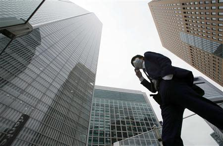 Businessman walks in Tokyo's business district