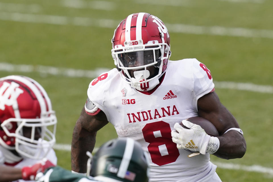 Indiana running back Stevie Scott III rushes during the second half of an NCAA college football game against Michigan State, Saturday, Nov. 14, 2020, in East Lansing, Mich. (AP Photo/Carlos Osorio)
