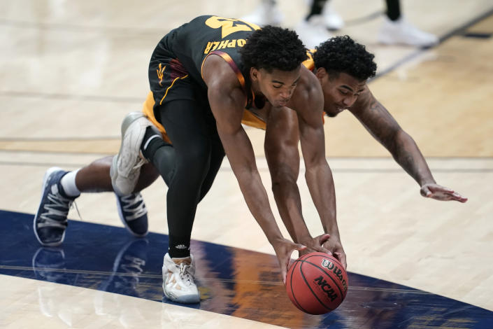 Arizona State guard Josh Christopher, left, reaches for the ball next to California forward Andre Kelly during the first half of an NCAA college basketball game in Berkeley, Calif., Thursday, Dec. 3, 2020. (AP Photo/Jeff Chiu)