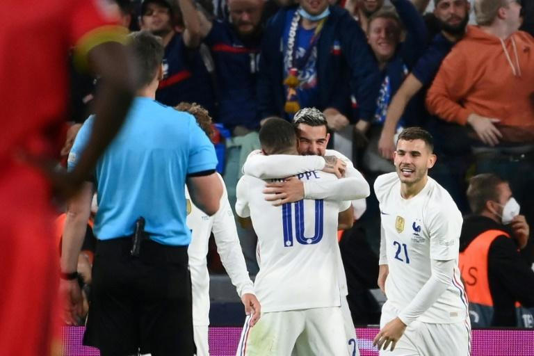Theo Hernandez and Kylian Mbappe were the architects of France's come-from-behind win over Belgium (AFP/FRANCK FIFE)