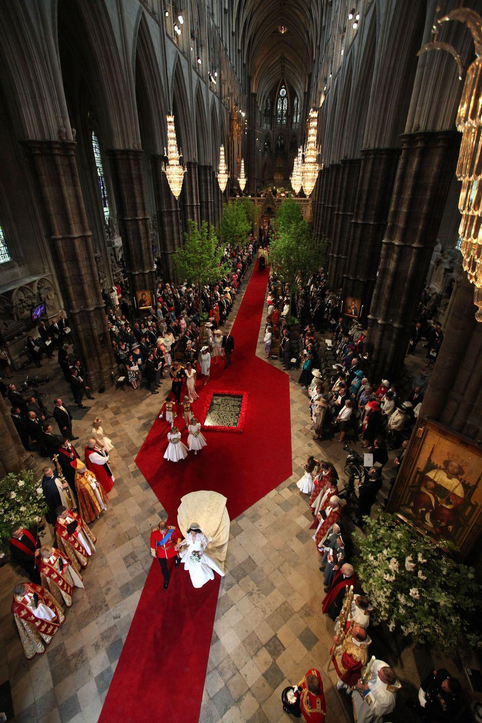 """<p>Six field maples and two hornbeams measuring up to 25-feet tall flanked the aisle along with <a href=""""http://www.bbc.com/news/uk-13212487"""" rel=""""nofollow noopener"""" target=""""_blank"""" data-ylk=""""slk:almost 30,000 flowers"""" class=""""link rapid-noclick-resp"""">almost 30,000 flowers</a> mostly grown at Windsor Great Park's Valley Gardens in Surrey. The neutral-colored blooms included azaleas as well as lily of the valley and myrtle in the bride's bouquet. <br></p>"""