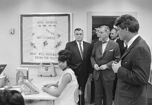 <p>Sen. Robert Kennedy, far left, tours the Manpower Development and Training Center at Greenville, Miss., April 12, 1967. (Photo: Jack Thornell/AP) </p>