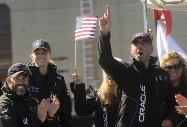 Oracle CEO Larry Ellison reacts after Oracle Team USA defeated Emirates Team New Zealand during Race 18 Emirates during Race 18 of the 34th America's Cup yacht sailing race in San Francisco, California September 24, 2013. REUTERS/Robert Galbraith (UNITED STATES - Tags: SPORT YACHTING BUSINESS SCIENCE TECHNOLOGY)
