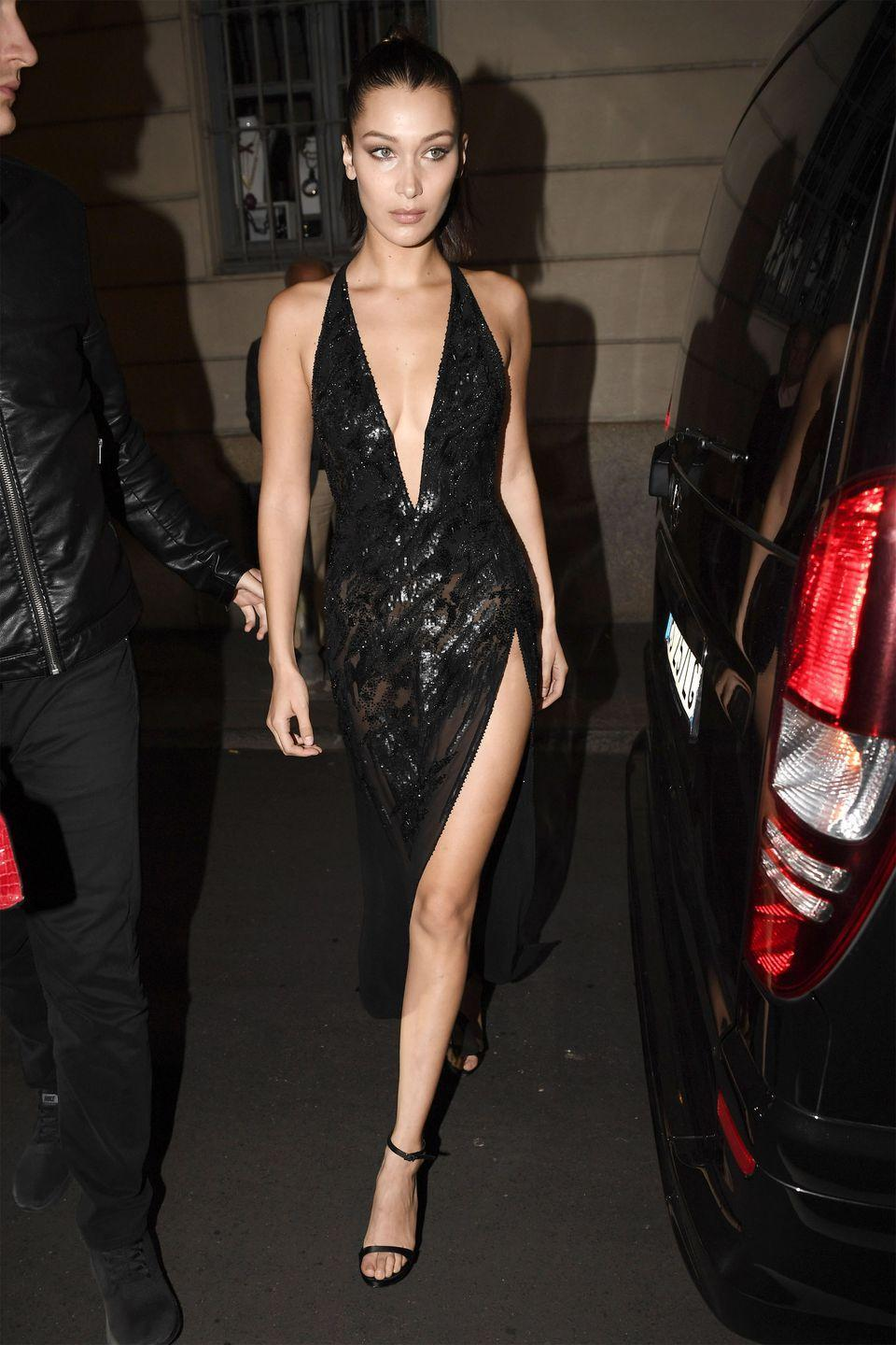 <p>In a black embellished gown with heeled sandals while leaving the Versace fashion show after party in Milan. </p>