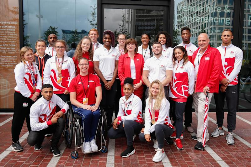 Nicky Morgan, Secretary of State for Digital, Culture, Media and Sport (C) poses with Team England athletes Photo: Getty Images for Birmingham 2022