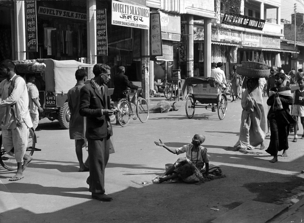 circa 1950: A beggar sits in the middle of the street in Banares, India. (Photo by Siegfried Sammer/Three Lions/Getty Images)