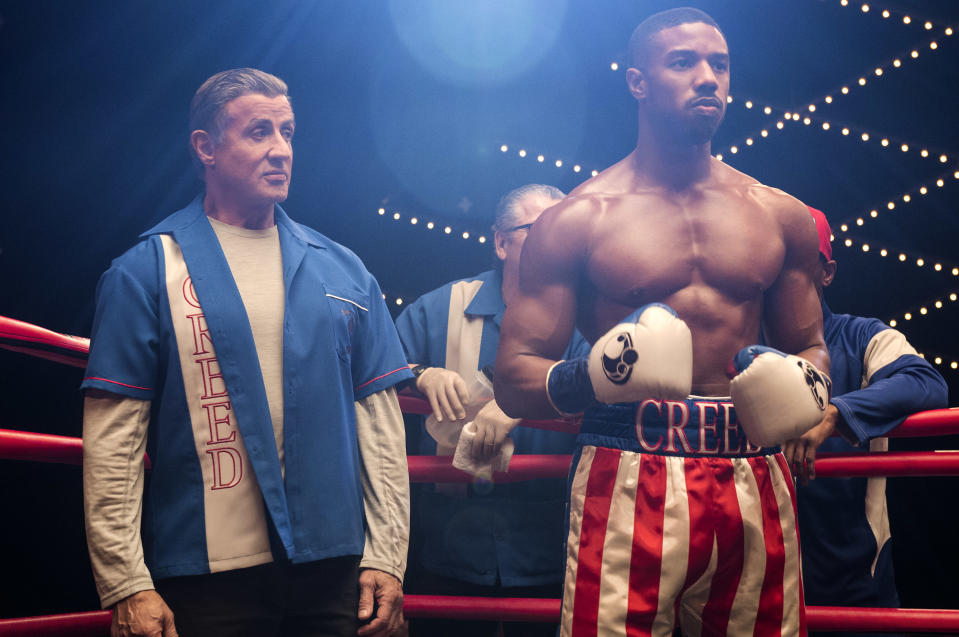 Rocky Balboa (Sylvester Stallone) stands by Adonis Creed (Michael B. Jordan) as he prepares to fight Drago Jr. in <em>Creed II</em>. (Photo: Barry Wetcher/Metro Goldwyn Mayer Pictures/Warner Bros. Pictures)