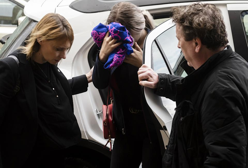 A British teenager (C) accused of falsely claiming she was raped by Israeli tourists, covers her face as she arrives for her trial at the Famagusta District Court in Paralimni in eastern Cyprus, on December 30, 2019. - The Briton who had alleged 12 Israeli tourists gang raped her on July 17, at a hotel in the eastern resort of Ayia Napa, has been found guilty of lying by a Cypriot court in Paralimni, her sentencing adjourned until January 7. (Photo by Iakovos HATZISTAVROU / AFP) (Photo by IAKOVOS HATZISTAVROU/AFP via Getty Images)