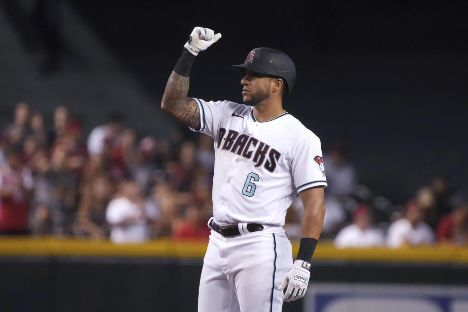 Arizona Diamondbacks' David Peralta reacts after hitting a double against the Los Angeles Angels during the fourth inning of a baseball game Friday, June 11, 2021, in Phoenix. (AP Photo/Rick Scuteri)