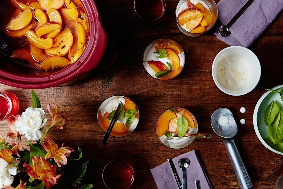 """Start cooking them right before dinner, and these boozy slow cooker honey-poached peaches will be ready just in time for dessert. <a href=""""https://www.epicurious.com/recipes/food/views/slow-cooker-amaretto-poached-peaches?mbid=synd_yahoo_rss"""" rel=""""nofollow noopener"""" target=""""_blank"""" data-ylk=""""slk:See recipe."""" class=""""link rapid-noclick-resp"""">See recipe.</a>"""