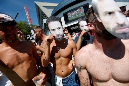 FILE PHOTO: World Cup - England fans watch Sweden vs England - Bristol, Britain - July 7, 2018 England fans with masks of England manager Gareth Southgate outside Ashton Gate Stadium Action Images via Reuters/Ed Sykes/File Photo