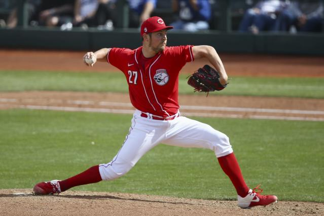 Cincinnati Reds pitcher Trevor Bauer throws against the Los Angeles Dodgers during the fourth inning of a spring training baseball game Monday, March 2, 2020, in Goodyear, Ariz. (AP Photo/Ross D. Franklin)