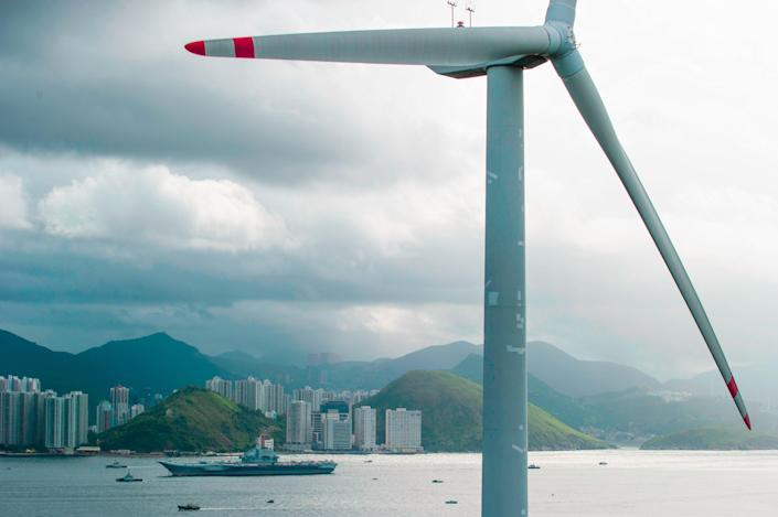 <p>Blowing in the wind: Renewable power sources, including wind power, enjoyed record growth in 2020</p> (AFP via Getty Images)