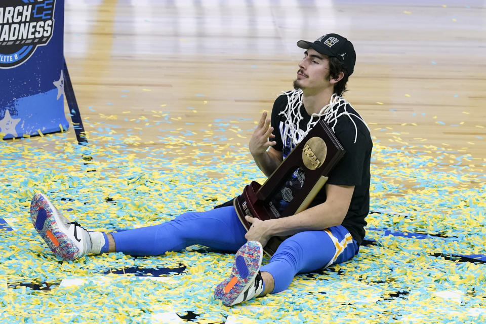 UCLA guard Jaime Jaquez Jr. celebrates after an Elite 8 game against Michigan in the NCAA men's college basketball tournament at Lucas Oil Stadium, Wednesday, March 31, 2021, in Indianapolis. UCLA won 51-49. (AP Photo/Darron Cummings)