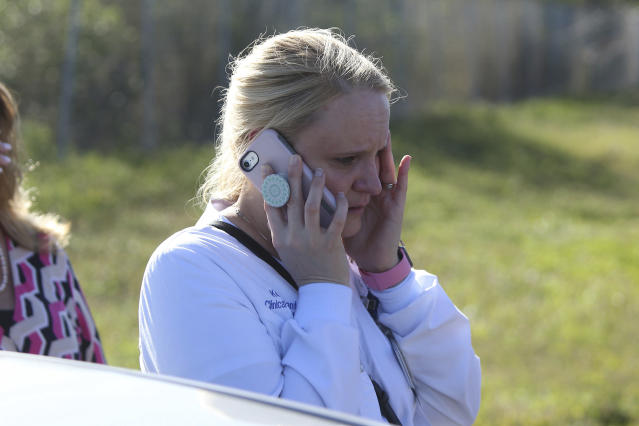 <p>A parent talks on cellphone waiting for news after a reports of a shooting at Marjory Stoneman Douglas High School in Parkland, Fla., on Feb. 14, 2018. (Photo: Joel Auerbach/AP) </p>