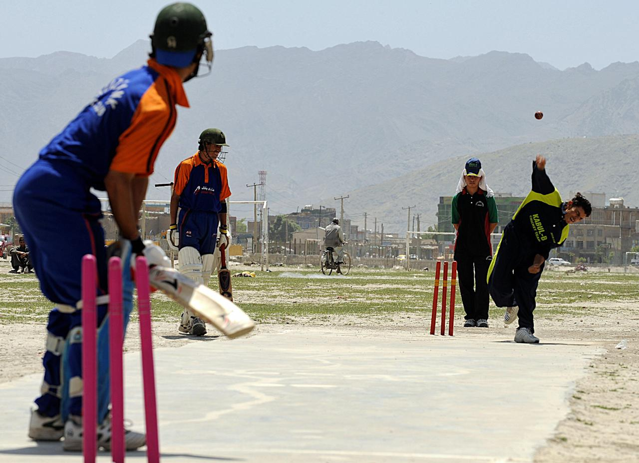 Afghan cricketers take part in a game in front of The Kabul Stadium in Kabul on May 1, 2008.   Cricket is popular among Afghans who have lived in Pakistan and recently returned to their country after decades of war. The national team will play eleven others in the International Cricket Council (ICC) World Cricket League Division 5 from May 23-31, on the island of Jersey. AFP PHOTO/SHAH Marai (Photo credit should read SHAH MARAI/AFP/Getty Images)