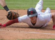 Cleveland Indians' Myles Straw slides safely back to first base ahead of a tag by Chicago White Sox's Gavin Sheets during the third inning of a baseball game in Cleveland, Sunday, Sept. 26, 2021. (AP Photo/Phil Long)