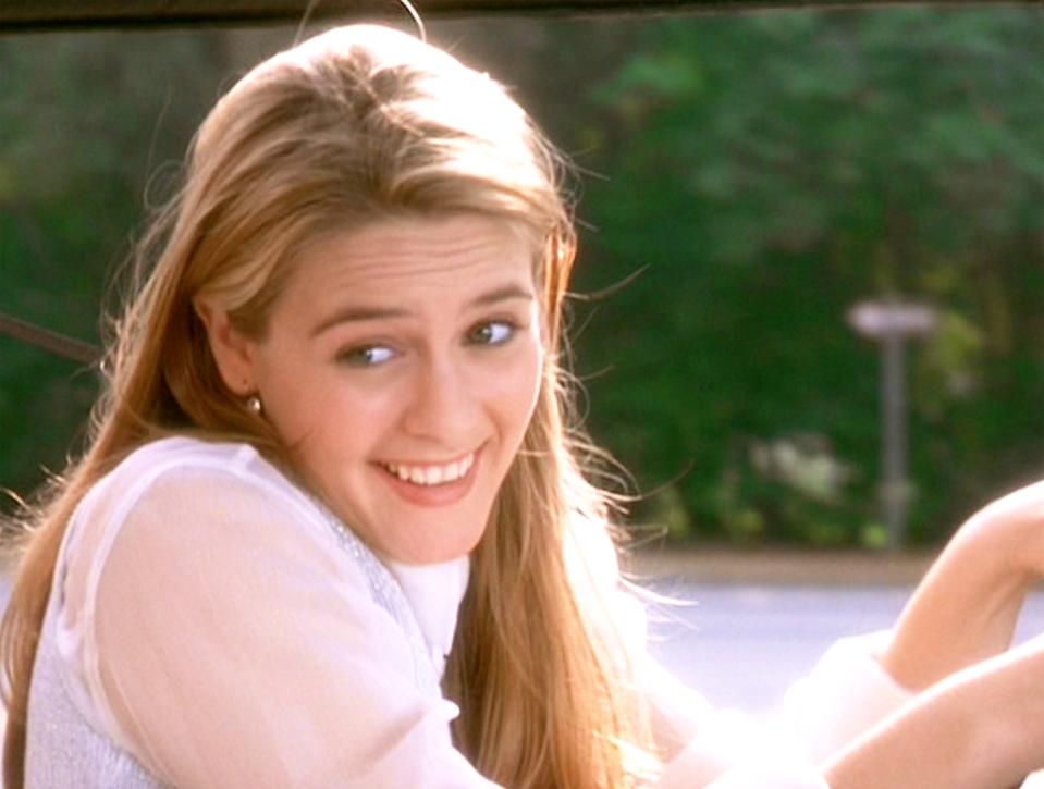 "LOS ANGELES - JULY 21: The movie ""Clueless"", written and directed by Amy Heckerling. Seen here, Alicia Silverstone as Cher (Cherilyn ""Cher"" Horowitz), on her way to failing her drivers test. Theatrical wide release, Friday, July 21, 1995. Screen capture. Paramount Pictures. (Photo by CBS via Getty Images)"
