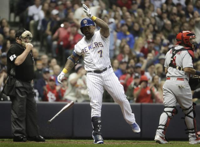 Milwaukee Brewers' Eric Thames reacts after striking out during the fourth inning of a baseball game against the St. Louis Cardinals Friday, March 29, 2019, in Milwaukee. (AP Photo/Morry Gash)