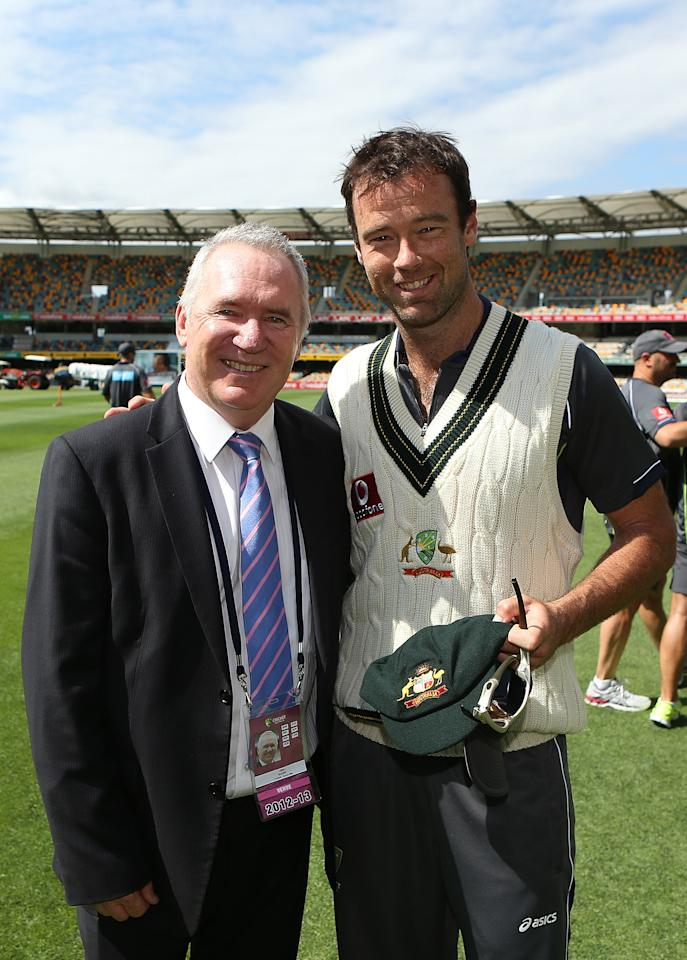 BRISBANE, AUSTRALIA - NOVEMBER 09:  Rob Quiney of Australia receives his baggy green from Allan Border during day one of the First Test match between Australia and South Africa at The Gabba on November 9, 2012 in Brisbane, Australia.  (Photo by Chris Hyde/Getty Images)