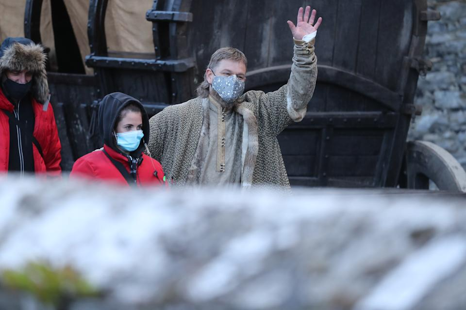 Matt Damon waves to the crowd as he leaves the set of the Last Duel, an historical drama-thriller film directed by Ridley Scott, at Cahir Castle in Co Tipperary.