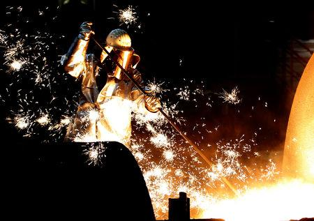FILE PHOTO: A worker of German steelmaker ThyssenKrupp controls a blast furnace in Duisburg