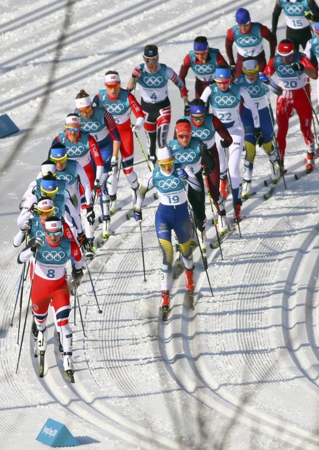 Cross-Country Skiing - Pyeongchang 2018 Winter Olympics - Women's 30km Mass Start Classic - Alpensia Cross-Country Skiing Centre - Pyeongchang, South Korea - February 25, 2018 - Marit Bjoergen of Norway leads the pack. REUTERS/Carlos Barria