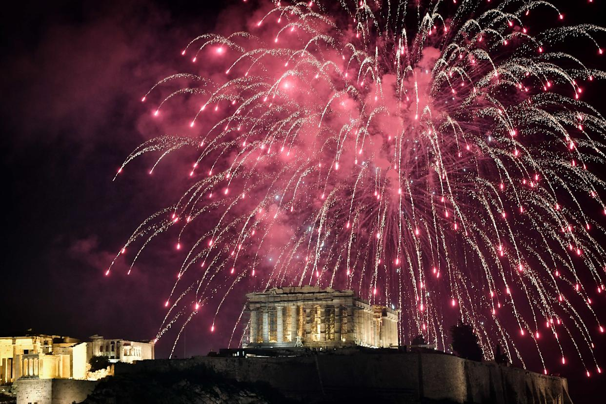 Fireworks explode over the Acropolis in Athens during New Year's celebrations on December 31, 2017. (Photo: LOUISA GOULIAMAKI via Getty Images)