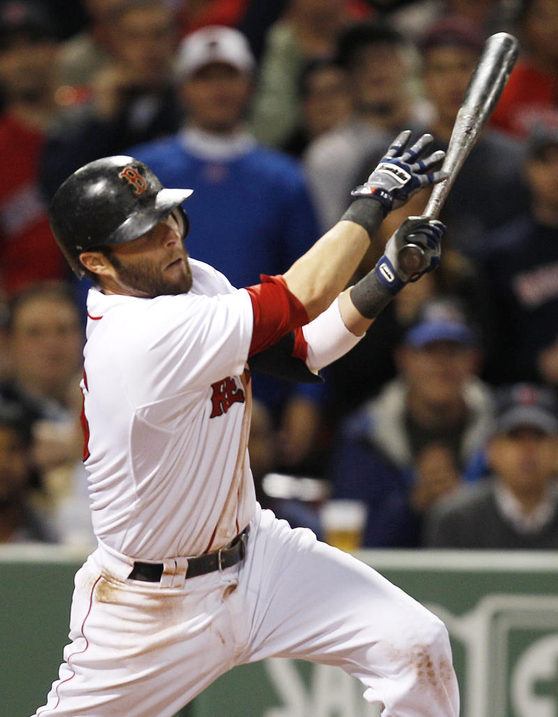 Boston Red Sox's Dustin Pedroia follows through on a two-run single off Los Angeles Angels starter Jered Weaver, on a 13-pitch at-bat, in the fifth inning of a baseball game in Boston, Monday, May 2, 2011. (AP Photo/Charles Krupa)