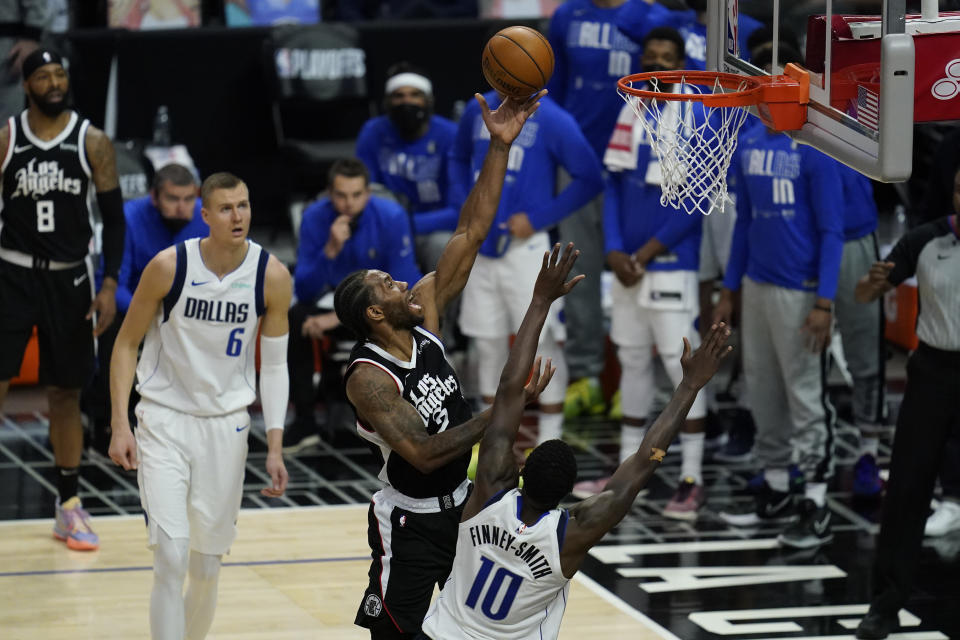 Los Angeles Clippers forward Kawhi Leonard (2) shoots against Dallas Mavericks forward Dorian Finney-Smith (10) during the third quarter of Game 7 of an NBA basketball first-round playoff series Sunday, June 6, 2021, in Los Angeles, Calif. (AP Photo/Ashley Landis)