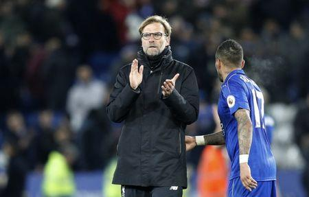 Liverpool manager Juergen Klopp applauds fans after the game