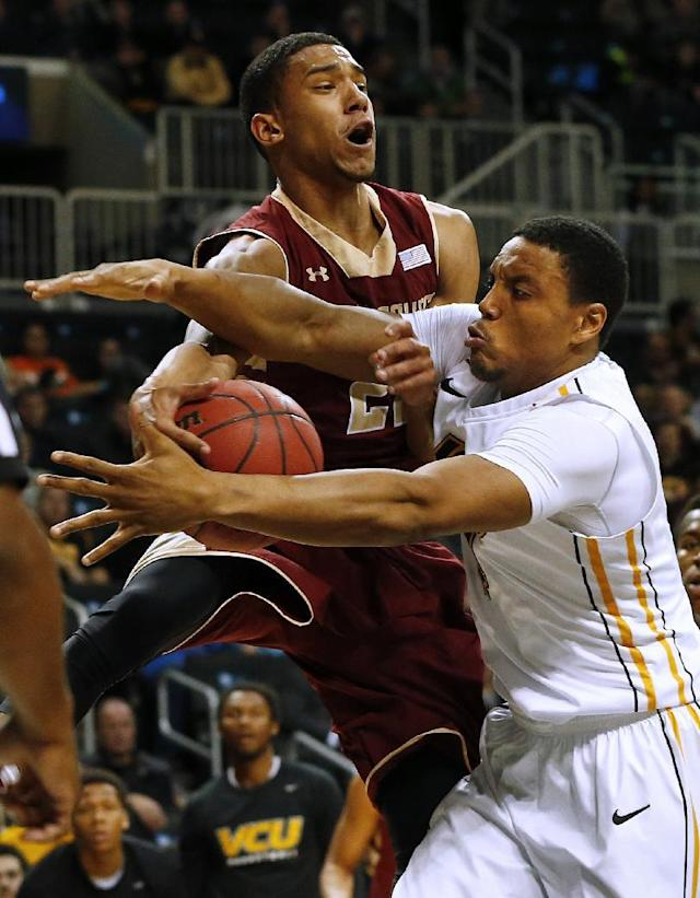 Boston College's Olivier Hanlan, left, attempts to pass but the ball is intercepted by VCU's Terrance Shannon during the first half of an NCAA college basketball game Saturday, Dec. 28, 2013, in New York. (AP Photo/Rich Schultz)