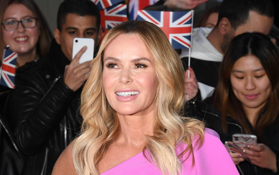 Amanda Holden, pictured at a Britain's Got Talent 2020 photocall in January, has lifted the spirits of the nation by taking her bin out in a couture gown. (Getty Images)