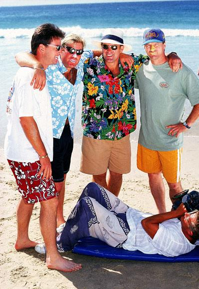 Australian cricketers Mark Waugh, Shane Warne, Mark Taylor and Steve Waugh pose for a beach cricket photo shoot October, 1997 on the Gold Coast, Australia. (Photo by Getty Images)