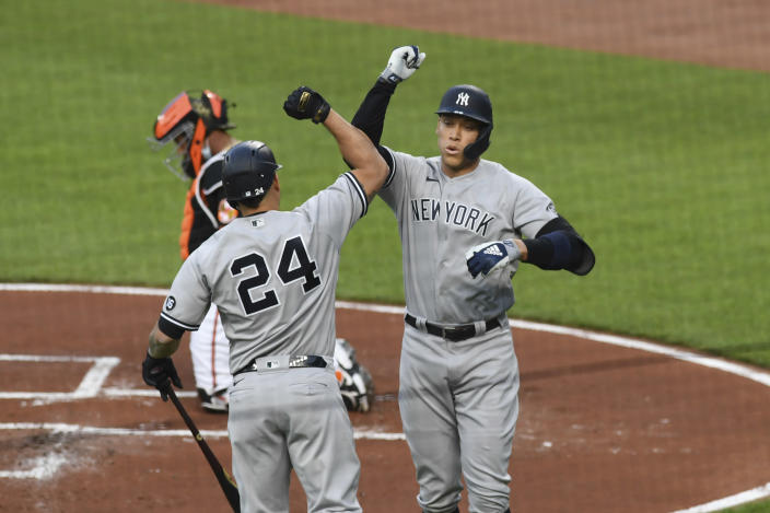 New York Yankees' Aaron Judge, right, celebrates with Gary Sanchez after hitting a first-inning home run against Baltimore Orioles starting pitcher Dean Kremer during a baseball game on Friday, May 14, 2021, in Baltimore. (AP Photo/Terrance Williams)