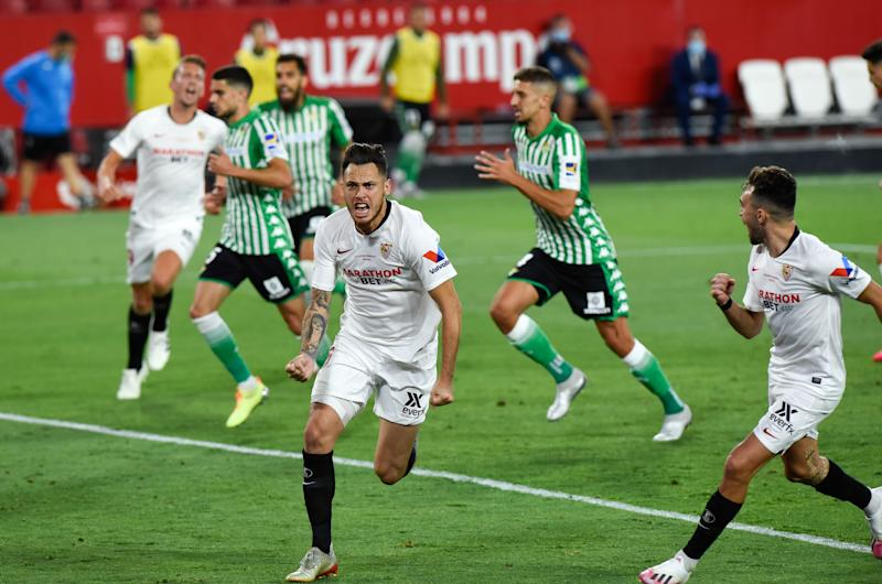 SEVILLA, SPAIN - JUNE 11: Lucas Ocampos of Sevilla celebrates after scoring the first goal of his team via penalty during the Spanish La Liga football match between Sevilla FC and Real Betis Balompie at Ramon Sanchez Pizjuan Stadium on June 11, 2020 in Sevilla, Spain. Spain's La Liga resumes season after nationwide lockdown amid ongoing coronavirus crisis. (Photo by AFP7 / Europa Press Sports via Getty Images)
