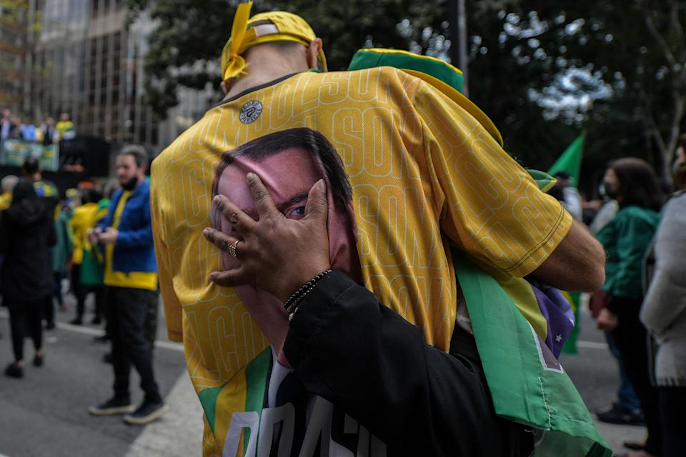TOPSHOT - Demonstrators take part in a rally in support of Brazilian President Jair Bolsonaro and calling for a printed vote model at Paulista Avenue in Sao Paulo, Brazil on August 1, 2021. - Thousands of Brazilians took to the streets Sunday to support far-right President Jair Bolsonaro in protest against the country's electronic voting system. (Photo by NELSON ALMEIDA / AFP) (Photo by NELSON ALMEIDA/AFP via Getty Images)