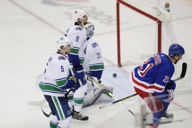 New York Rangers' Brett Howden (21) celebrates after scoring a goal as Vancouver Canucks goaltender Jacob Markstrom (25), Christopher Tanev (8) and Derrick Pouliot (5) react during the third period of an NHL hockey game Monday, Nov. 12, 2018, in New York. The Rangers won 2-1. (AP Photo/Frank Franklin II)