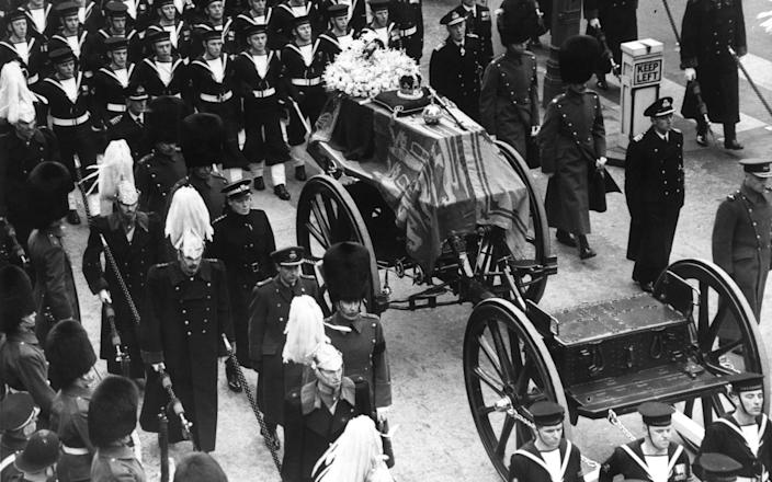 The coffin of King George VI lies on a gun carriage drawn by naval officers, and accompanied by men of the Household Cavalry on February 15, 1952 - Derek Berwin/Hulton Royals Collection
