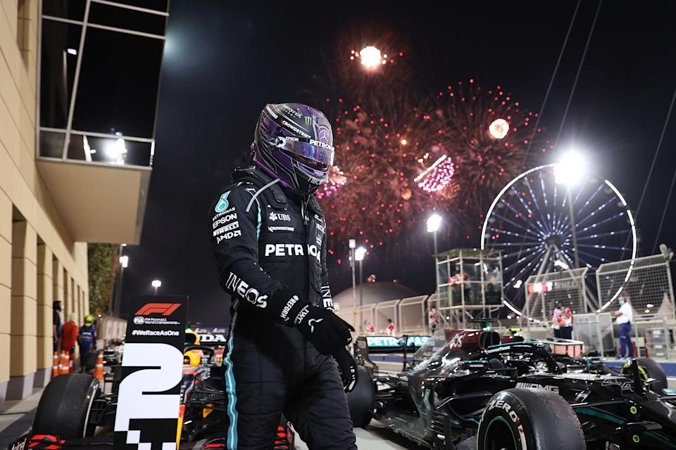 BAHRAIN, BAHRAIN - MARCH 28: Race winner Lewis Hamilton of Great Britain and Mercedes GP looks on in parc ferme during the F1 Grand Prix of Bahrain at Bahrain International Circuit on March 28, 2021 in Bahrain, Bahrain. (Photo by Lars Baron/Getty Images)