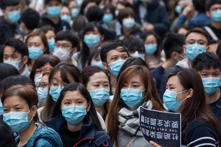 Medical workers wearing protective masks gather during a protest outside the Hospital Authority's head office in Hong Kong, China, on Feb. 4, 2020. | Paul Yeung/Bloomberg via Getty Images
