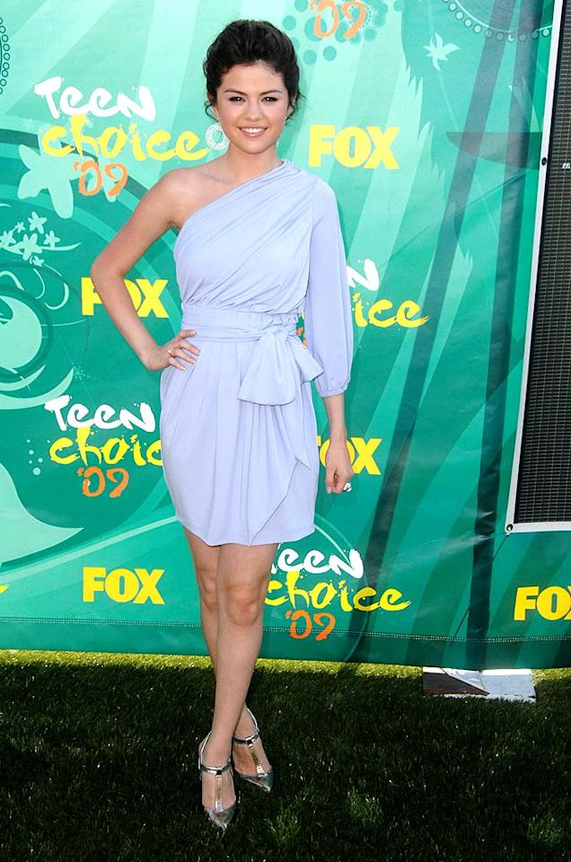 "Why does tween queen Selena Gomez insist upon wearing age-inappropriate ensembles? Her materonly updo, snooze-worthy wrap dress, and T-bar sandals belong on a granny, not a Disney darling. Steve Granitz/<a href=""http://www.wireimage.com"" target=""new"">WireImage.com</a> - August 9, 2009"